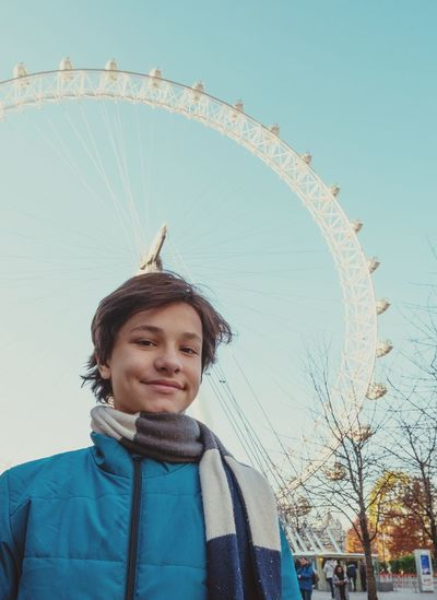 EyeEm LOST IN London Travel Destinations One Person Smiling Winter Leisure Activity Happiness One Man Only Vacations Low Angle View People Portrait Arts Culture And Entertainment Day Outdoors Clear Sky Sky Cold Temperature London Eye London Lifestyle Londoncity London Trip An Eye For Travel The Portraitist - 2018 EyeEm Awards #urbanana: The Urban Playground