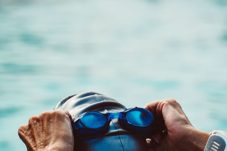 Close-Up Of Man Wearing Swimming Goggles In Pool