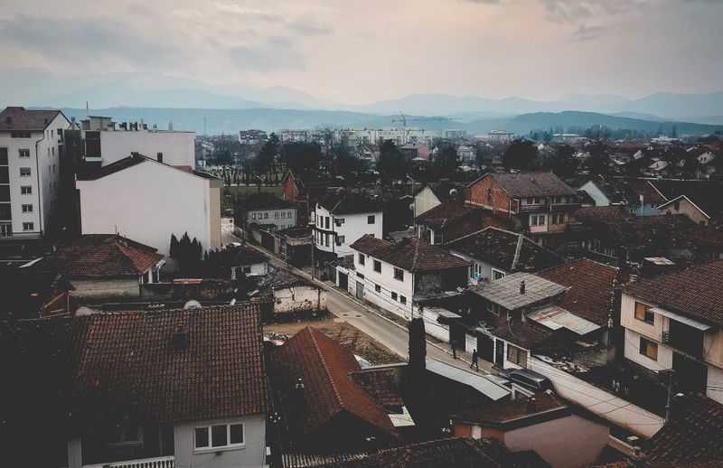 View EyeEm Gallery EyeEmNewHere EyeEm Best Shots Photographer Photography Gjakova Architecture Building Exterior Built Structure Residential District Cityscape City Crowded House Sky Residential Building High Angle View Town Outdoors Mountain Roof Day Community Residential  People
