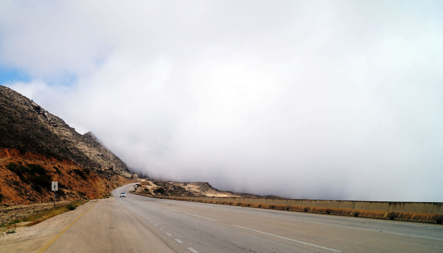 Beauty In Nature Cloud - Sky Clouds Day Highway Mountain Mountain Road Muscat Nature No People Outdoors Road Salalah 🇴🇲 Scape Scenics Sky The Way Forward Transportation