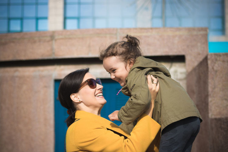 Mother and daughter love. Togetherness Two People Bonding Emotion Love Positive Emotion Women Child Family Parent Outdoors Girl Daughter Mother Offspring Holding Fun City Smiling Happiness Caucasian Lifestyles Simple Life Enjoyment Care
