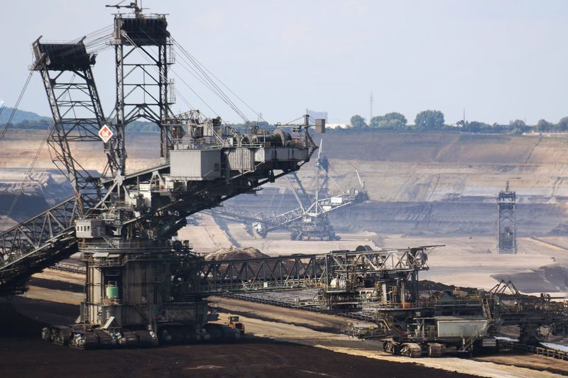 Brown coal surface mining - open cast coal mining. Huge bucket wheel excavator. new developed technology. Supposed to be more environmentally friendly. Bucket Wheel Excavator Construction Machinery Day Development Engineering No People Open Cast Mining Progress