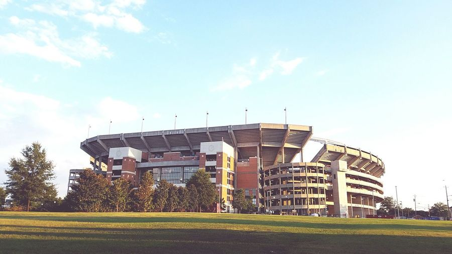 Bryant Denny Stadium Grass Architecture Built Structure Building Exterior Sky Tree Lawn Field Growth Cloud Outdoors Day Green Color Grassy Office Building No People Garden Cloud - Sky Agriculture Façade