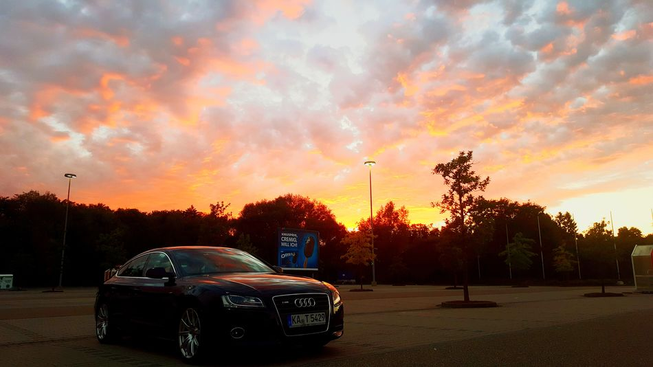 Car Sunset Cloud - Sky No People Sky Day Audi Outdoors Lifestyles Red Orange Color Sunlight Orange Sun Yellow