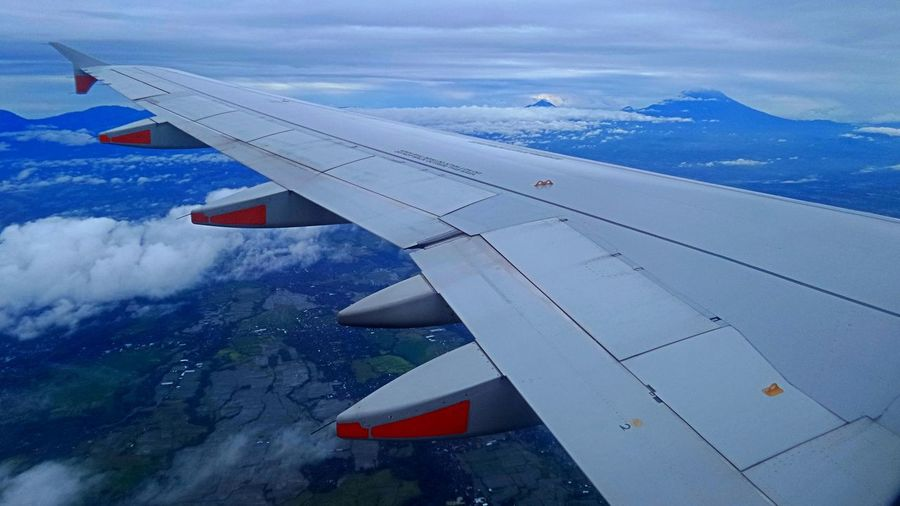 Fly over Bali Island. Bali Bali Indonesia Travel Aerial View Agung Aircraft Wing Airplane Airplane Wing Altitude Cloud - Sky Day Eyem Gallery Flight Flying High Angle View Joseph Jeanmart Landscape Ngurahraiairport No People Raining Season Rice Field Sky Sunrise Travel Destinations Volcano