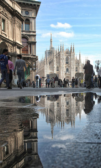 Milan Cathedral Reflecting On Puddle