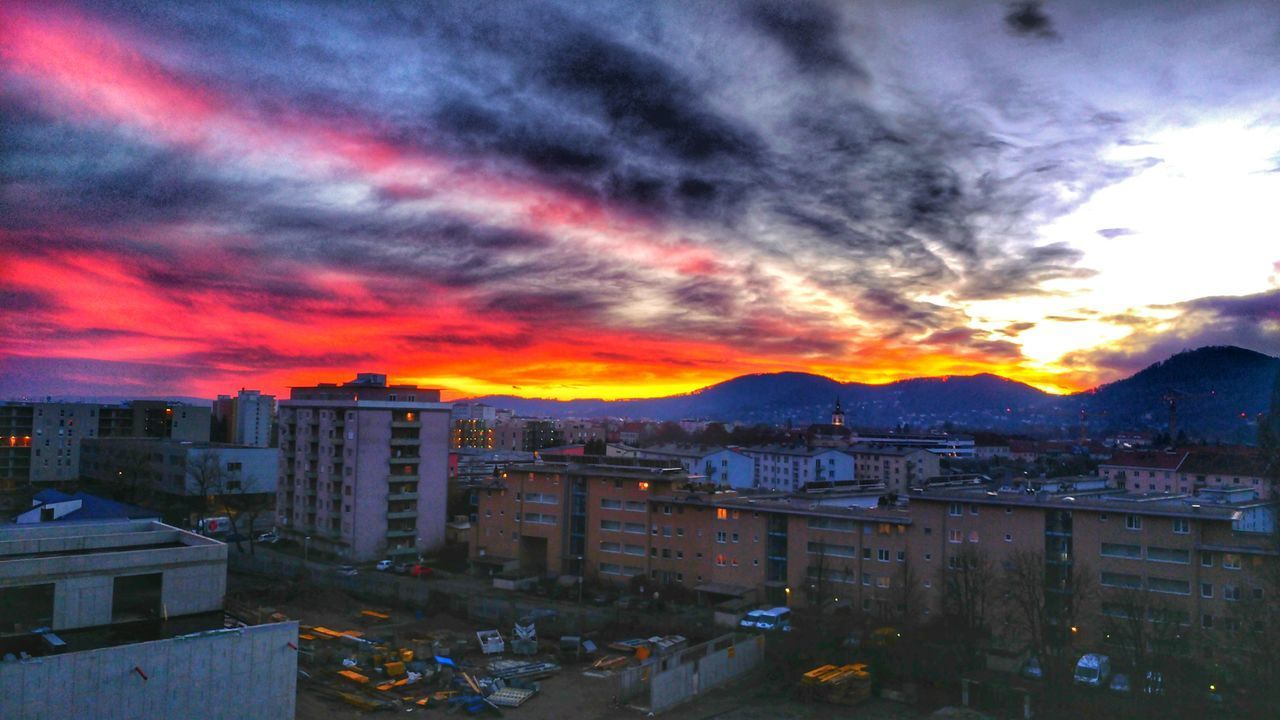 architecture, sky, cloud - sky, building exterior, sunset, built structure, city, building, orange color, cityscape, residential district, no people, nature, high angle view, dramatic sky, mountain, outdoors, illuminated, romantic sky, ominous
