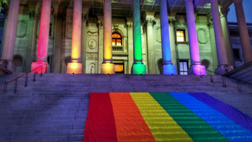 Remembering the massacre at Pulse Orlando (6/12/16 - 1/18) -- HonorThemWithAction Lovealwayswins -- The Photojournalist - 2017 EyeEm Awards HDR Hdr_Collection Hdrphotography Multi Colored Architecture Built Structure Architectural Column Window No People Illuminated Dusk Dusk In The City City Urban Statehouse Building Building Exterior Flag Pride Flag Light And Shadow Lights Night Lights