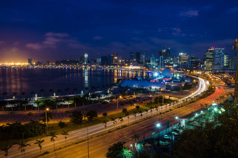 High angle view of light trails on road in city at night, luanda, angola, africa