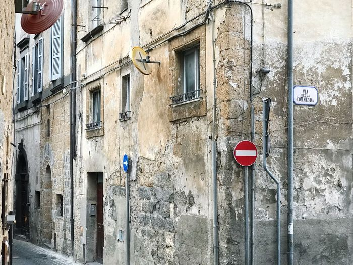 Old town Traffic Sign Built Structure Building Exterior Architecture Building Day Window Communication Wall Sign Wall - Building Feature No People Residential District Outdoors City Safety Full Frame