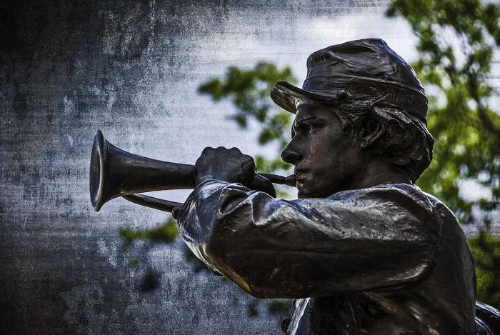 Gettysburg Bugler: Statue of a bugler from the Gettysburg National Military Park. Battlefield Civil War Gettysburg Gettysburg National Military Park Heroic Pennsylvania Statue War Memorial Bugle  Bugler Civil War Era Civil War History History Memorial Monument No People Outdoors Sculpture Statue