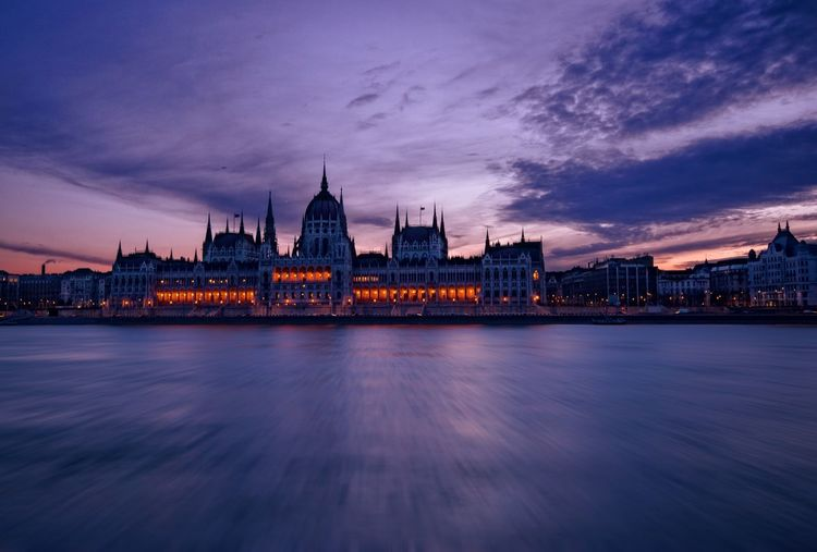 Hungarian parliament building against sky at dusk