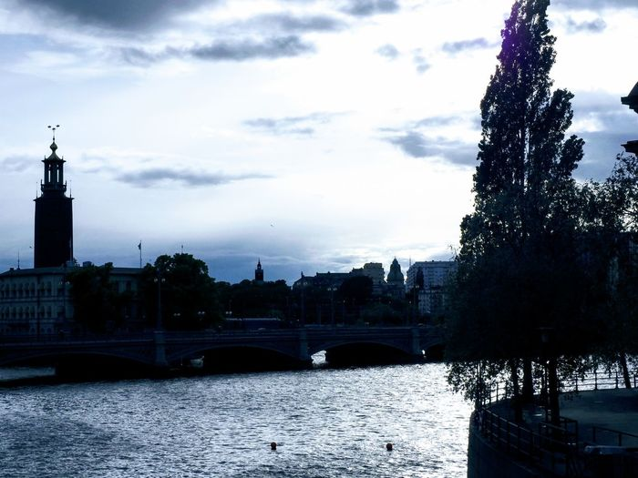 Reflection Outdoors Outdoor Photography Daylight Tourism Stockholm Sweden Sunlight Skyline Travel Photography City Water Tree Sky Architecture Cloud - Sky River Arch Bridge Riverbank Bridge Waterfront Silhouette Bridge - Man Made Structure The Traveler - 2018 EyeEm Awards Outline Canal Place Of Interest Atmospheric Mood Dramatic Sky Moody Sky