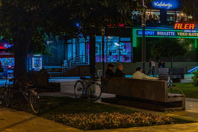 White bicycle Night Bicycle Street People Street Photography People Walking  Bike Lights Urban Plaza Serbia Benches City Lights Bench Pirot Mode Of Transport Bikes Dark Serbian Streets Streets People Sitting On A Bench Group Of People Real People Transportation Land Vehicle Plant Tree Mode Of Transportation Men Architecture Building Exterior City Nature Illuminated Sitting Lifestyles Built Structure Outdoors The Street Photographer - 2019 EyeEm Awards