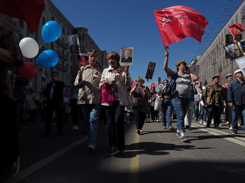 The Victory day procession at Tverskaya street in Moscow Red Moscow, Russia Red Flag Victory Day May 9 9 May 2018 Procession Moscow Russia Group Of People Real People Balloon Men Crowd City Large Group Of People Street Celebration Outdoors Day Women Architecture