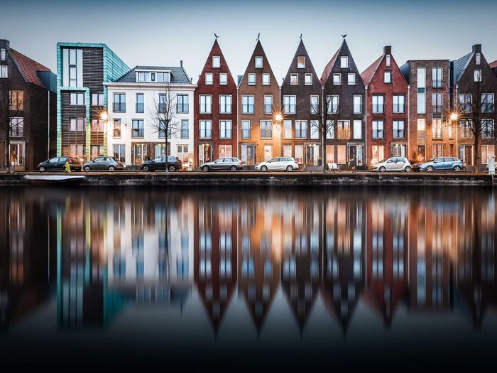 Dutch houses EyeEmNewHere Colors Long Exposure Architecture Building Exterior Built Structure House No People Outdoors Day Residential Building Water Sky Travel Destinations Sea City Nautical Vessel The Architect - 2018 EyeEm Awards EyeEmNewHere