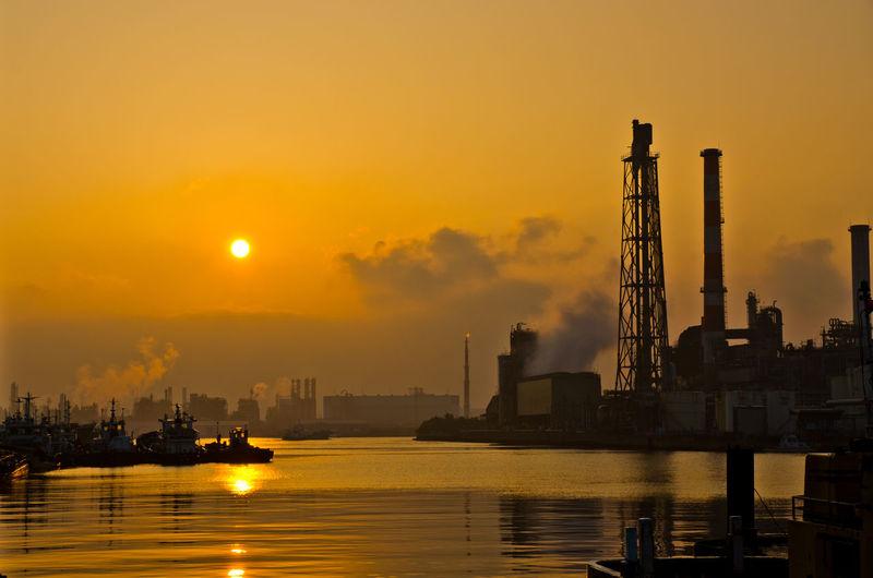 Commercial dock against sky during sunrise
