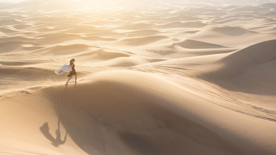 High angle view of woman walking in desert