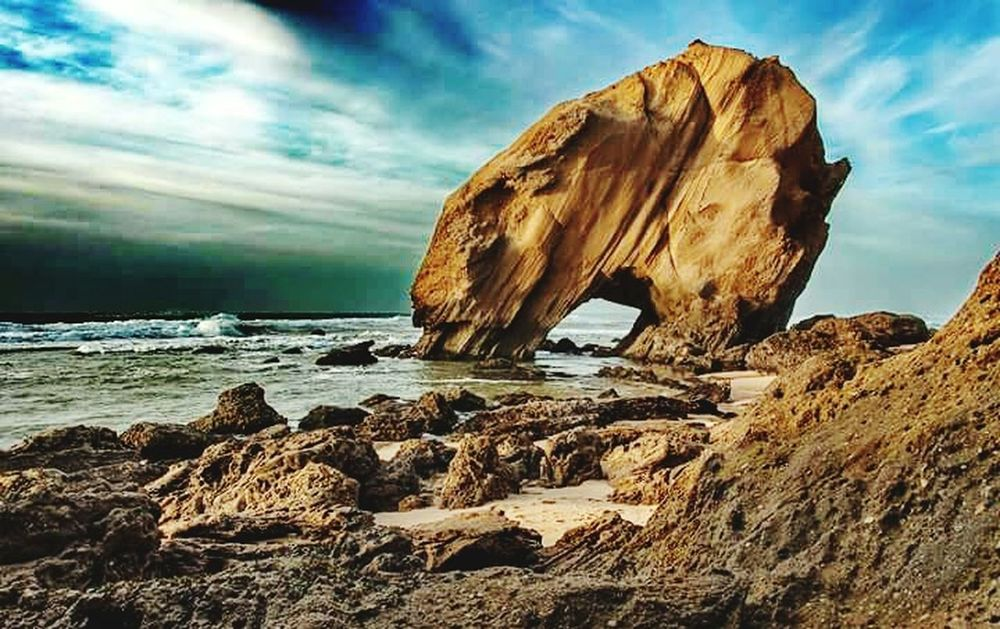 Sea Rock - Object Cliff Large Sand Wave Beach No People Outdoors Cloud - Sky Nature Landscape Sky Day