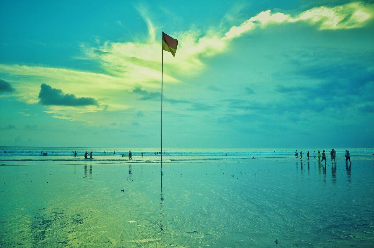 Indonesian Flag Against Sky On Beach