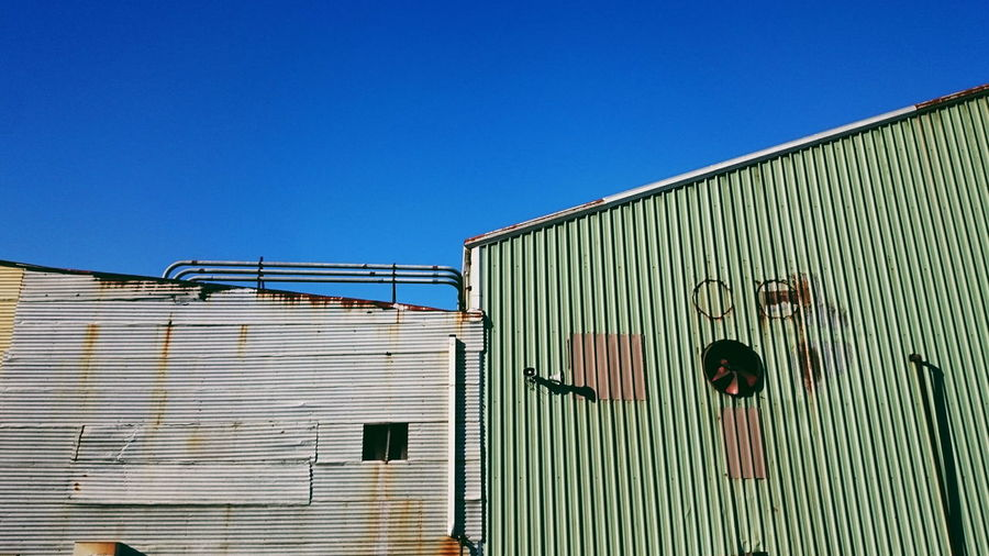 Metal structure against clear blue sky