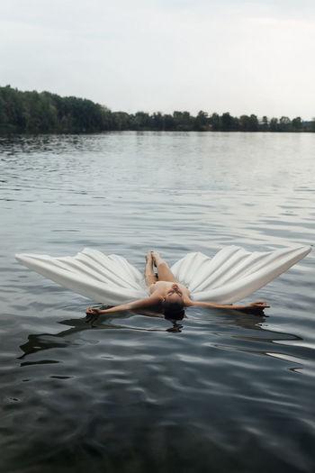 Woman lying in lake