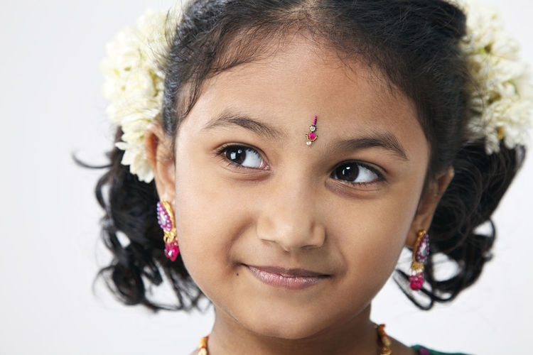 portrait of malaysia indian ethnicity celebrating deepavali Asian  Diwali Females Happiness Indian Innocence Traditonal Clothing Childhood Cute Deepavali  Elementary Age Hairstyle Headshot Holding Indoors  Malaysia One Person Portrait Sari Smiling Studio Shot Traditonal Festival Women