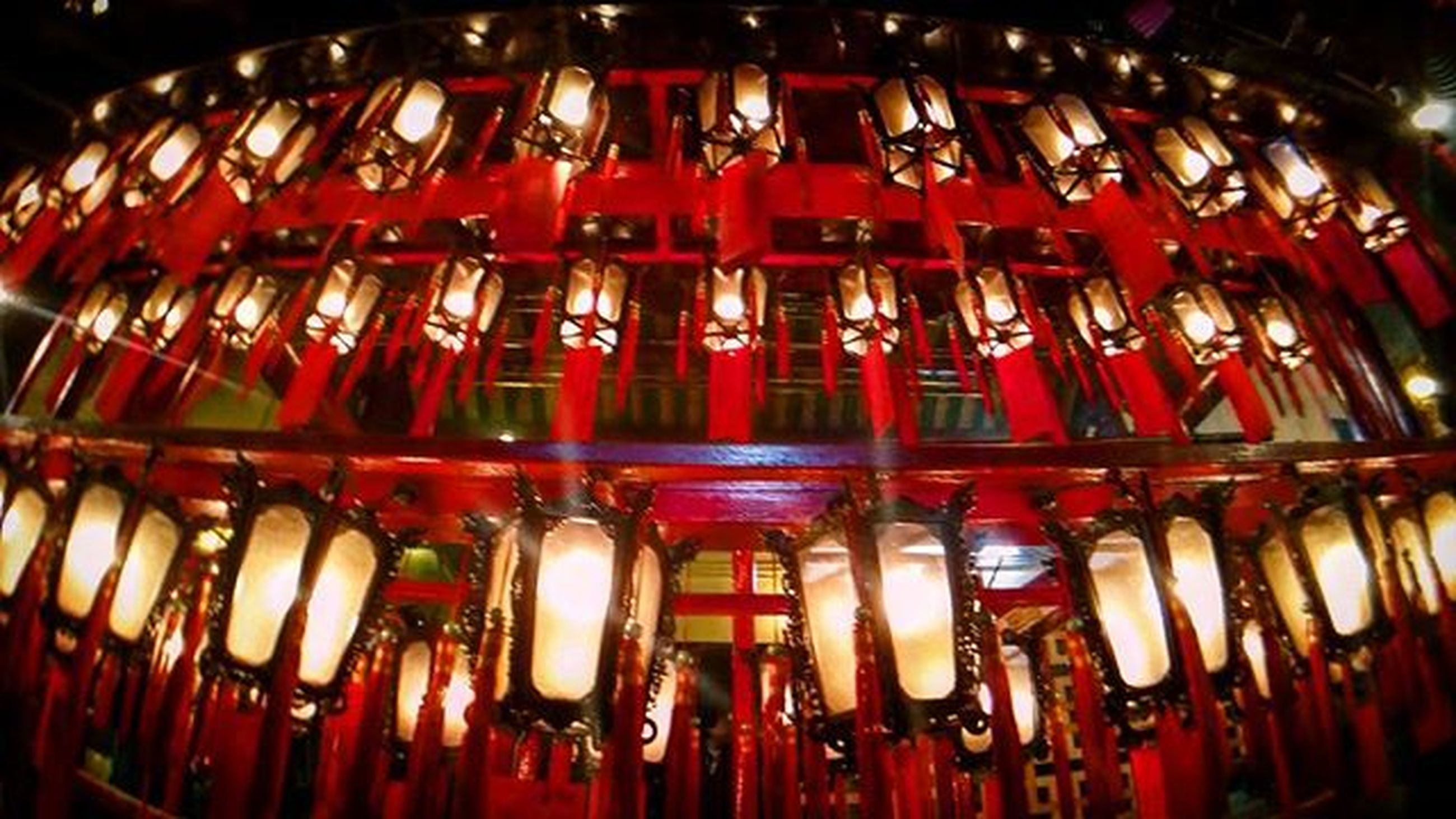 indoors, illuminated, in a row, red, hanging, large group of objects, abundance, lighting equipment, night, order, repetition, close-up, side by side, lantern, metal, tradition, no people, low angle view, decoration, arrangement