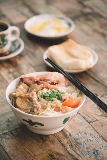 Hearty seafood noodles Food And Drink Food Bowl Healthy Eating Ready-to-eat Asian Food Kitchen Utensil Wellbeing Freshness Meal Chopsticks Eating Utensil Soup Indoors  Vegetable High Angle View Spoon Japanese Food No People Seafood