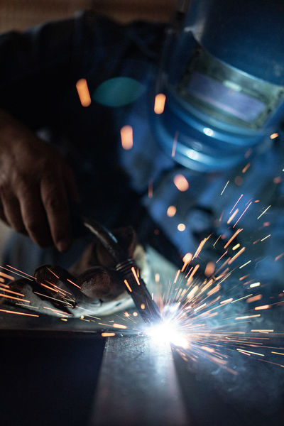 Blurred Motion Burning Finger Fire Heat - Temperature Human Body Part Human Hand Illuminated Industry Metal Metal Industry Motion Occupation One Person Skill  Sparks Welding Working