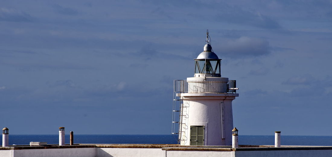 lighthouse Mallorca EyeEm Selects Water Nautical Vessel Sea Lighthouse Beach Photograph Radar Harbor Business Finance And Industry Tower