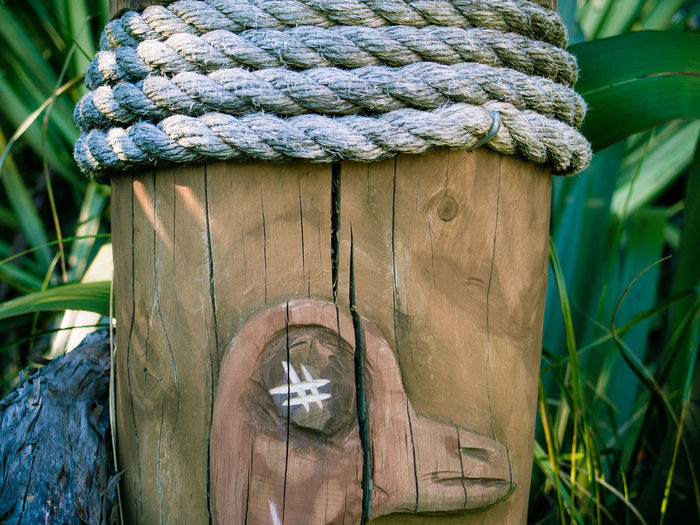 Rope tied around wooden post