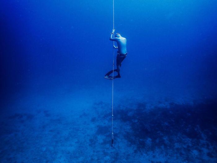 Man free diving in sea