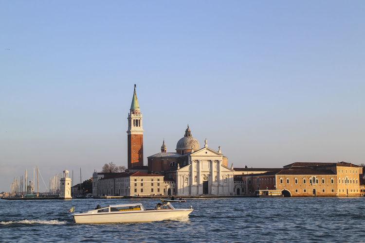 Church of san giorgio maggiore by grand canal against clear sky