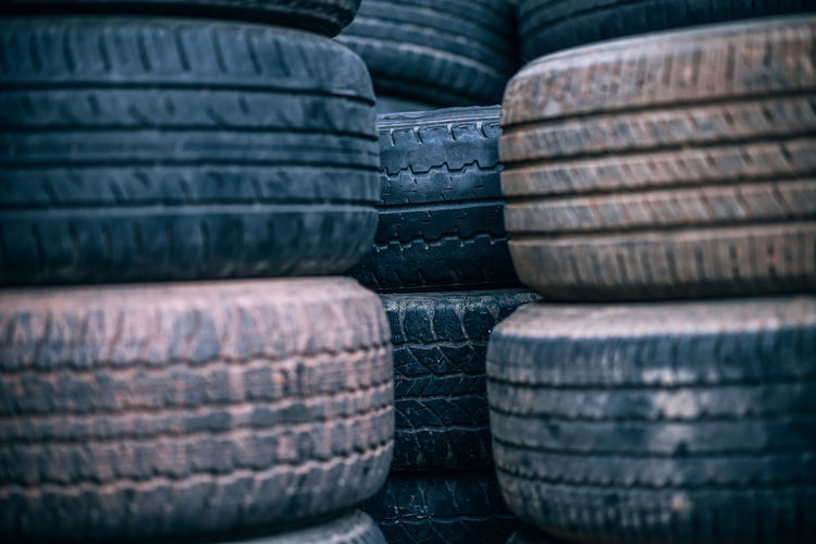 Stacked Used Tires Automobile Junk Abundance Architecture Arrangement Auto Automotive Balance Black Black Color Car Closeup Dirty Dump Industry No People Order Repetition Rubber Rubber Tire Stack Tire Truck Tyre Wheel