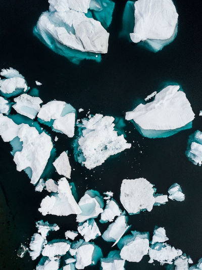 Aerial view of icebergs melting in sea