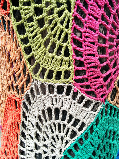 Yarn bombing. Close-up of tree trunk covered with colorful knits Artistic Tree Tree Trunk Yarn Bombing Backgrounds Close-up Closeup Colorful Cover Crochet Day Full Frame Knit Knitted  Knitting Knitwear Multi Colored No People Outdoors Pattern Preserve Street Street Art Trunk Tree Urban Art