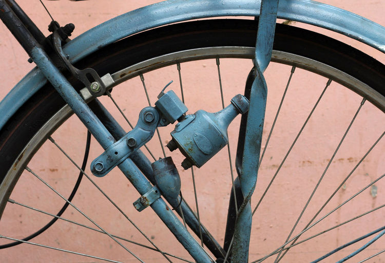 Close-up of bicycle against wall