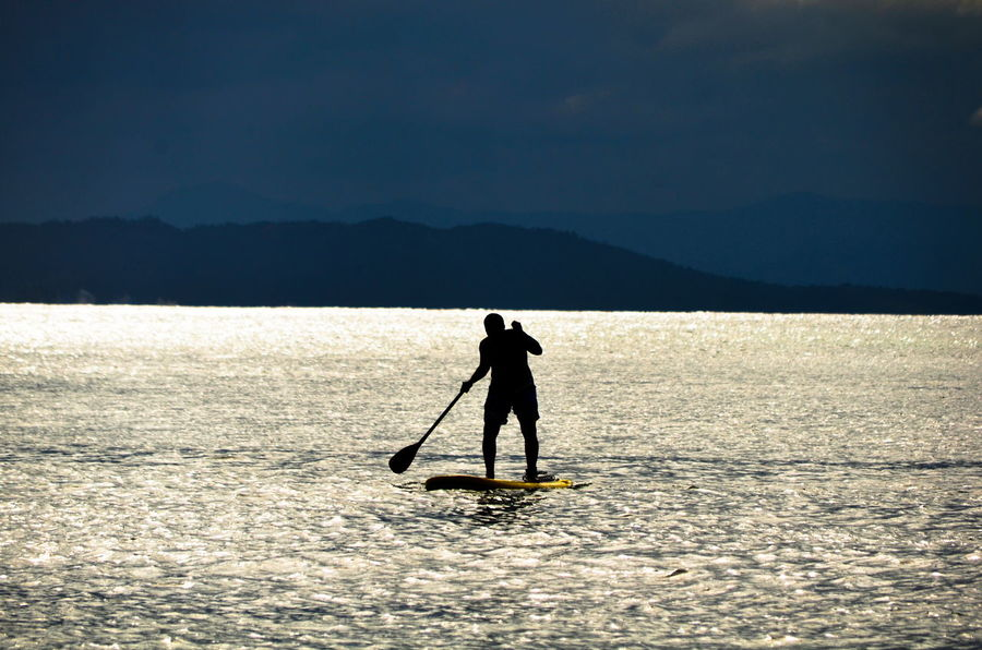Full Length One Person Outdoors Adult Lake Adults Only Silhouette One Man Only Mature Adult People Standing Day Nature Sport Men Adventure Water Paddleboarding Beach Beauty Sea Horizon Over Water Brasil Desolate Desolate Scene