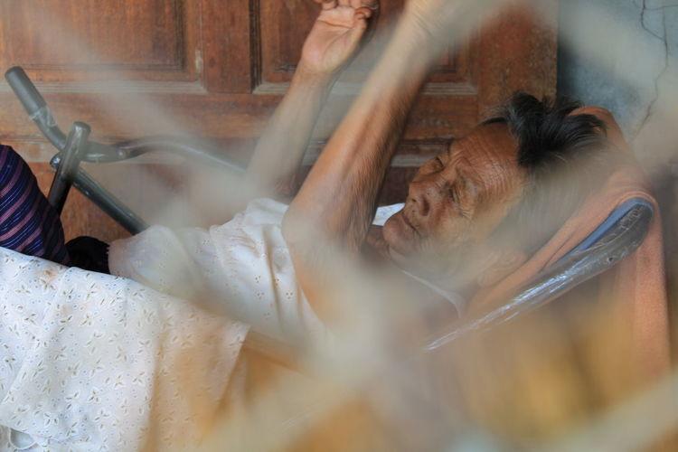 Senior woman sleeping in the house.
