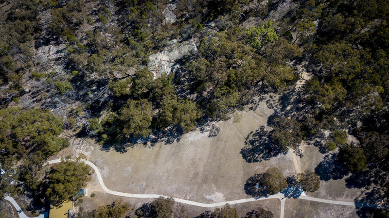 Wineries and granite rocks in Stanthorpe Aerial View Beauty In Nature Day Environment Forest Growth High Angle View Land Motion Nature No People Outdoors Plant Scenics - Nature Tranquil Scene Tranquility Transportation Tree Water