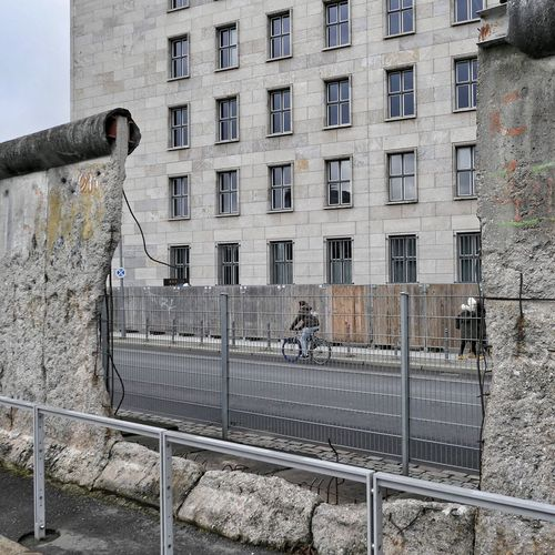 Berlin Wall Berlin Germany Bicycle Architecture Building Exterior Transportation City Built Structure Outdoors One Person Cycling Men Day Street Light Real People Full Length One Man Only Adult