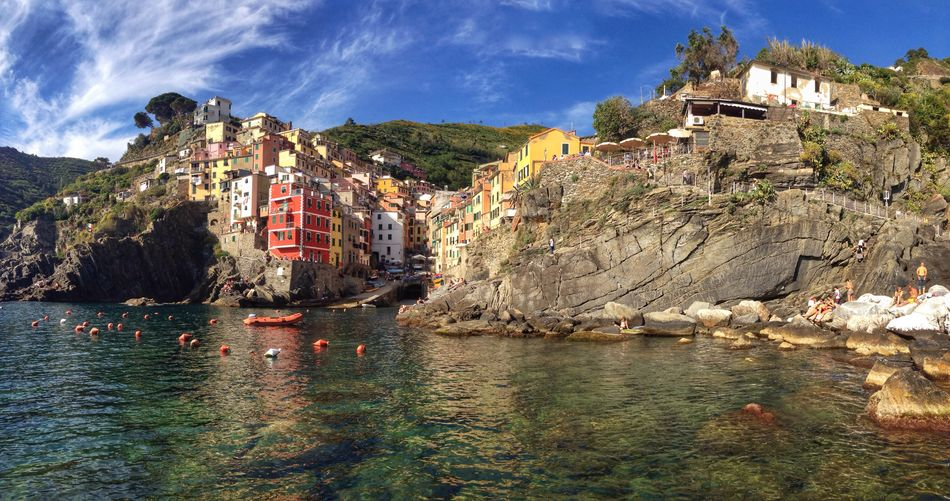 Riomaggiore, Cinque Terre, Italy Architecture Building Exterior Built Structure Water Outdoors Rock - Object Mountain Waterfront Travel Destinations Cliff Nature River Day Sky No People Town Scenics Beauty In Nature Tree Cinque Terre Italy Riomaggiore