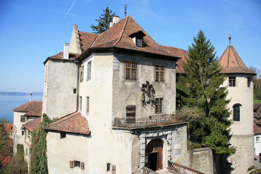 Castle Meersburg in Germany Castle Meersburg Architecture Building Building Exterior Built Structure Clear Sky Day Germany Nature No People Old Outdoors Roof Roof Tile Sky Sunlight Tree Window