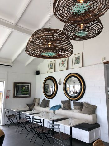 Upcycling Seaside Mirror Restaurant EyeEm Selects Indoors  Ceiling Hanging No People Lighting Equipment Home Interior Chandelier Decoration Table Seat Day Wall - Building Feature Low Angle View Luxury Architecture Chair