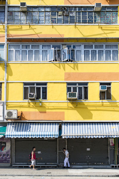 Paint The Town Yellow Window Yellow Building Exterior Outdoors Day City Architecture People Adult Colorful EyeEm Best Shots Streetphotography Street Photography The Week On EyeEm Colour Your Horizn