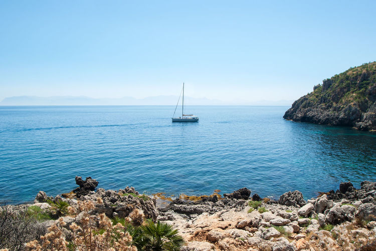 Zingaro Natural Reserve, Sicily, Sicily Zingaro Reserve Beauty In Nature Blue Clear Sky Horizon Horizon Over Water Luxury Mode Of Transportation Nature Nautical Vessel No People Rock Rock - Object Sailboat Scenics - Nature Sea Sky Solid Tranquil Scene Transportation Water Yacht Yachting Zingaro