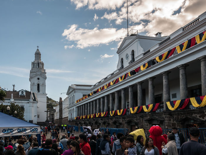 QUITO, ECUADOR - AUGUST 10, 2018: QUITO, ECUADOR - AUGUST 10, 2018: People begin filling up Quito's downtown area to celebrate Ecuador's independence day. Celebration Downtown Event Holiday Independence Old Town Quito Traveling Architecture Building Building Exterior Built Structure City Crowd Ecuador Group Of People Independence Day Large Group Of People Men People Real People Sky Travel Travel Destinations Women #urbanana: The Urban Playground