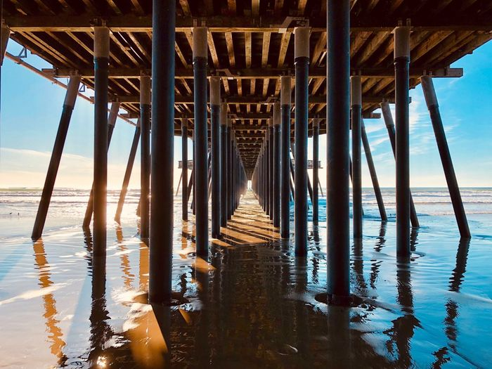 Water Sea Pier Built Structure Nature Sky Underneath Architecture Beach No People Land Architectural Column Day Reflection Connection Sunlight Beauty In Nature Wood - Material Horizon Over Water Outdoors