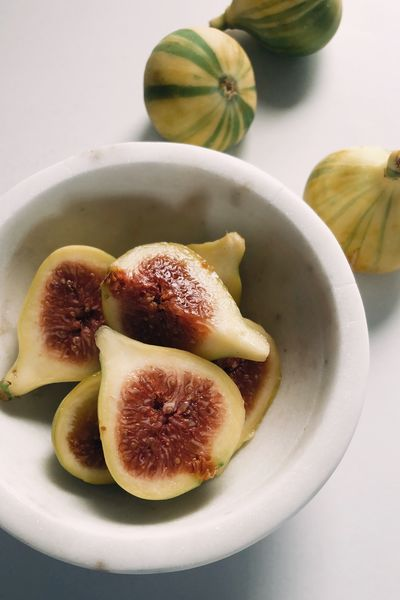 Fresh tiger figs in a white marble bowl Healthy Fruit Fresh Food And Drink Food Healthy Eating Fruit Freshness Wellbeing SLICE Still Life Indoors  No People Plate Bowl Close-up Table Group Of Objects Fig Group